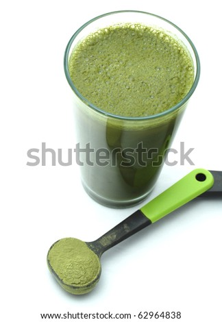 Green Health Drink with Tablespoon of Green Powder. Could be a Green Super Food Drink mixed with spirulina, chorella, barley grass, broccoli, spinach, wheat grass, &/ or blue green algae. - stock photo