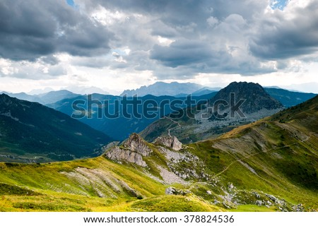 green hills, grazing animals, and beautiful mountain views in a European landscape. - stock photo