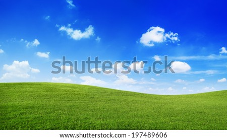 Green hills with blue sky. - stock photo