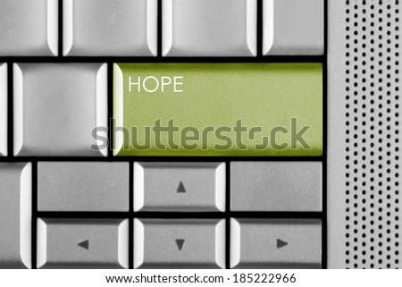 Green HOPE key on a computer keyboard  - stock photo