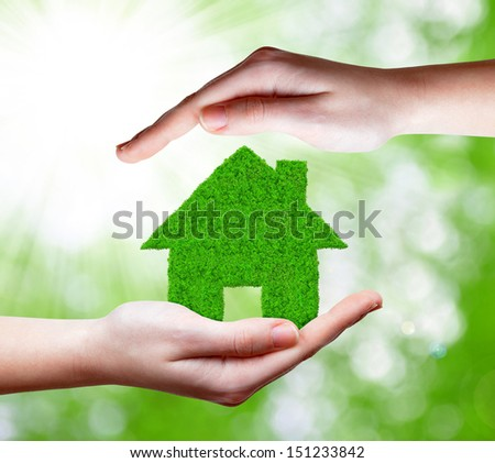 green house in hands  - stock photo