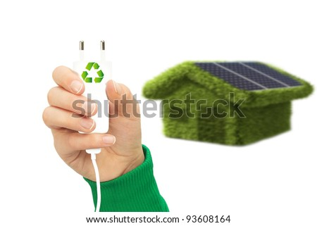 Green house with solar power - stock photo
