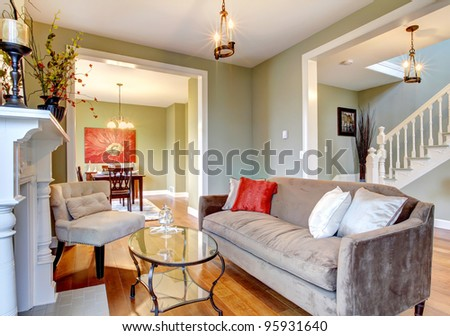 Green interior with cherry wood floor and nice furniture. - stock photo