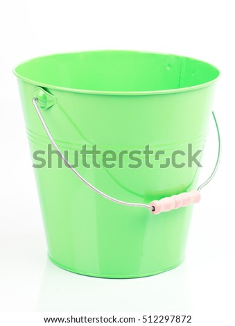 Green iron/metal bucket/pail/container with handle isolated on white background. Colorful kid child toys. Garden equipment.