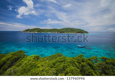 Green island in blue sea.