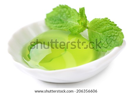 Green jelly with mint leaves isolated on white - stock photo