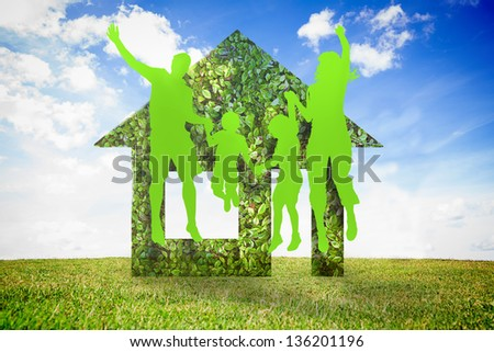 Green jumping family against green house - stock photo