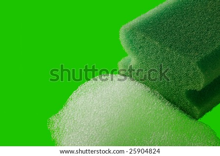 green kitchen sponge with foam on green background - stock photo