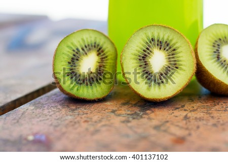 Green kiwi on a wooden table, selective focus, horizontal