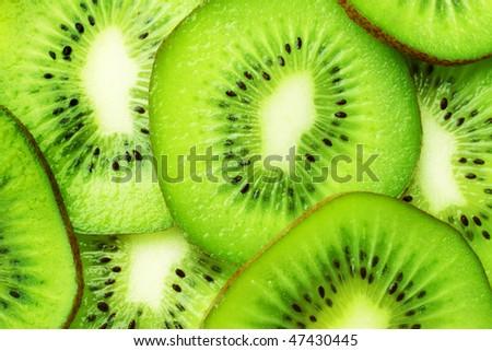 green kiwi slices wallpaper - stock photo