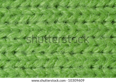Green knitted wool close up - stock photo