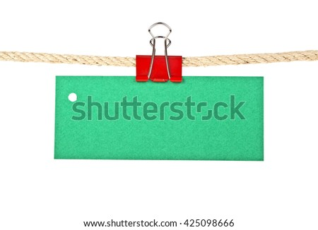 Green label on a rope isolated on white background, closeup - stock photo
