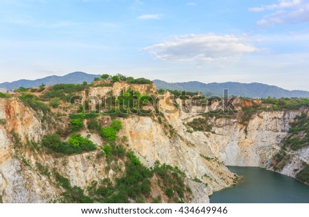 Green lake in reservoir rock in nature, Grand canyon old mine site , Chonburi Thailand - stock photo