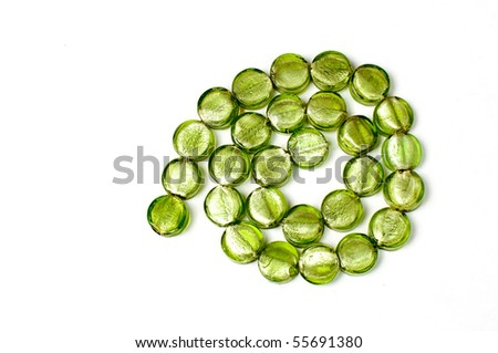 green lampwork round beads isolated on white background - stock photo