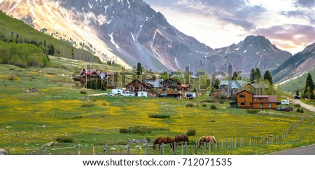 Green Landscape In Spring Time Of The Country Farm With Horse House And Mountain As