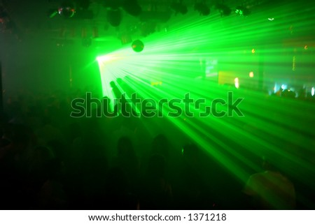 Green lasers at a night club. - stock photo