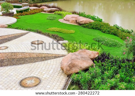 Green lawn decoration in the garden. - stock photo