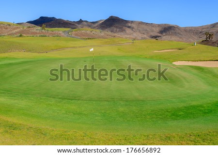 Green lawn field of a golf course in Las Playitas town, Fuerteventura, Canary Islands, Spain - stock photo
