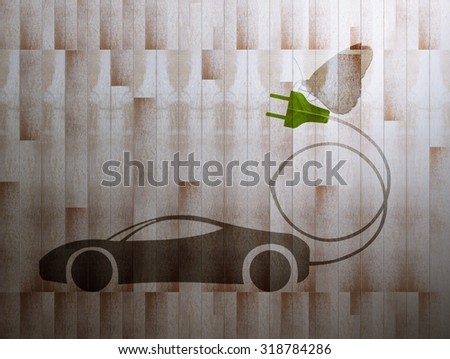 green leaf with a cut out car symbol on wood board background, Ecology concept - stock photo
