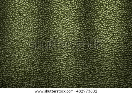 Green leather texture background for design with copy space for text or image. Pattern of leather that occurs natural.