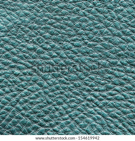 green leather texture closeup. Useful as background for design-works.