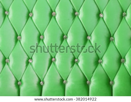 Green leather texture of sofa blur picture.