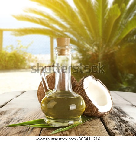green leaves of palm and oil of coconut in bottle