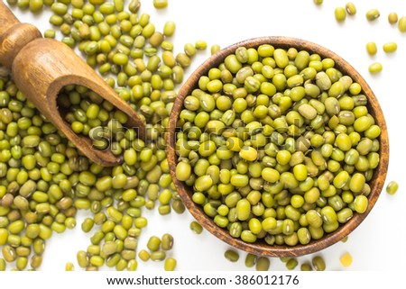Green lentils in a wooden bowl - stock photo