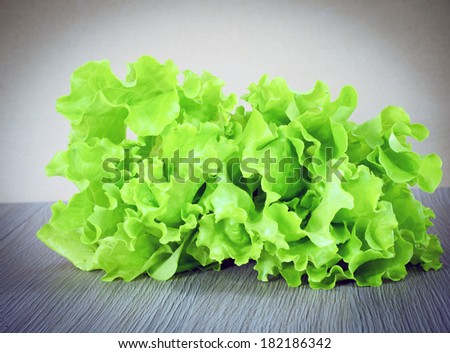 Green lettuce over Retro Woody Background - stock photo