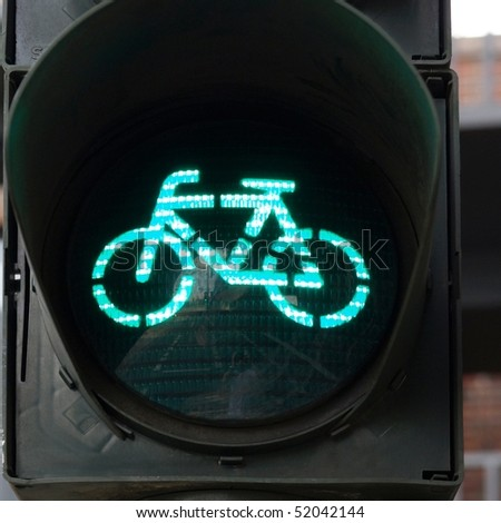 Green light for bycicle lane on a traffic light - stock photo