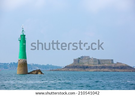 Green lighthouse in the bay of Saint-Malo, Brittany, France - stock photo