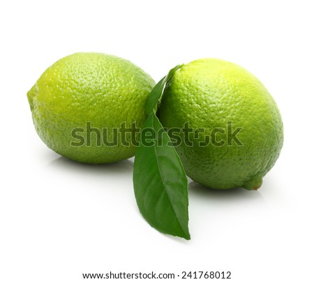 Green lime with leaf isolated on white background - stock photo