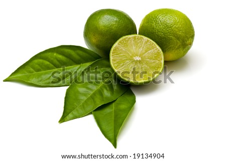 Green limes isolated on white - stock photo