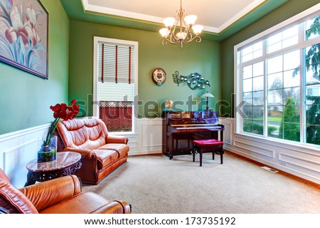 Green living room with wide window, carpet floor and brown furniture. Great piano spot - stock photo