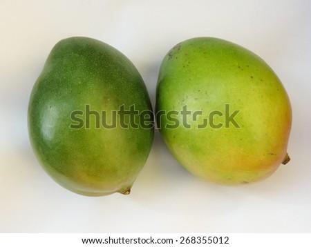 green mango fruit over white background - stock photo