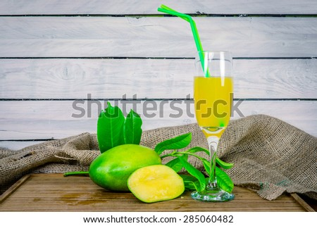 Green mango juice on a wooden table - stock photo