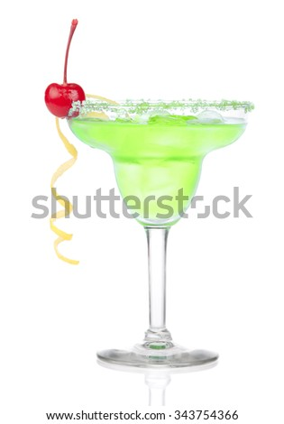 Green Margarita cocktail with red cherry in chilled salt rimmed glass with tequila, orange syrup, tequila, lemon spiral, crushed ice in cocktails glass isolated on white background  - stock photo