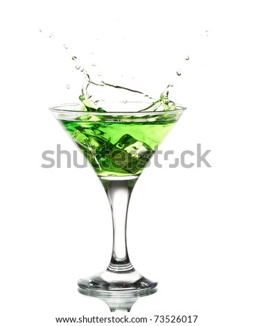 green martini cocktail splashing into glass on white background - stock photo