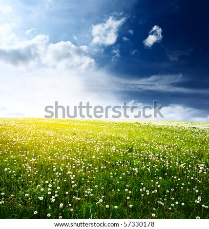 Green meadow and blue sky with clouds - stock photo