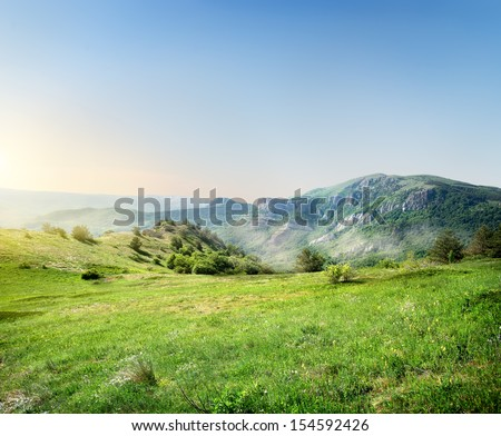 Green meadow on the background of the Crimean mountains - stock photo