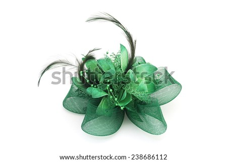 green mesh bow hair clip with feather  on white background - stock photo