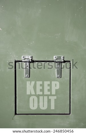 Green metal container with hinged door, keep out - stock photo