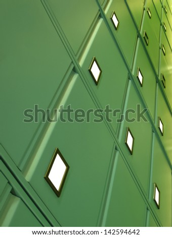 Green metal filing cabinet at an angle - stock photo