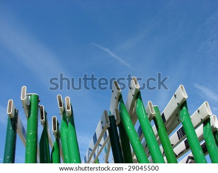 Green Metal Track Hurdles and Blue Sky - stock photo