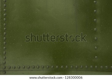 Green Metal with Bolt Heads Photo Background. - stock photo