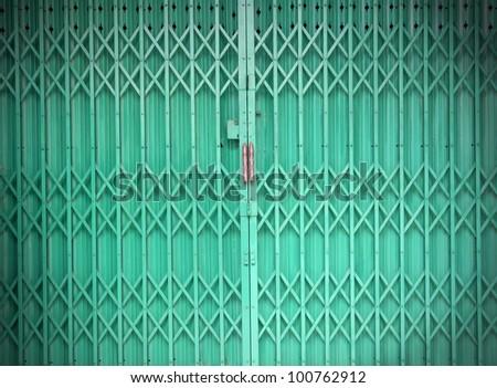 green metallic door - stock photo