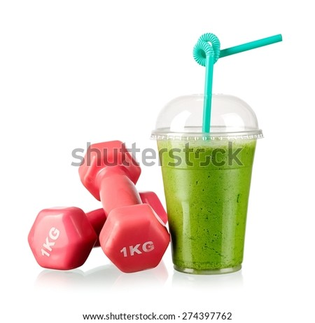 Green milk smoothie and two dumbbells  - stock photo