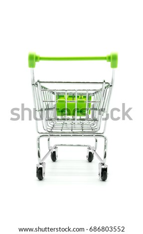 Green miniature shopping cart isolated on white background