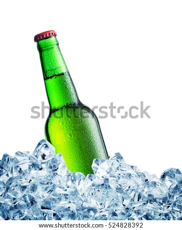 Green misted over bottle of the beer on ice isolated on white background