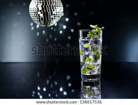 Green Mojito cocktail with fresh mint leaves - stock photo